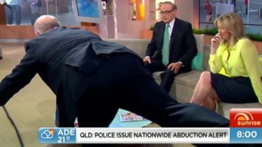 Bent double: Samantha Armytage chuckles as David Koch attempts the one-legged Romanian deadlift.