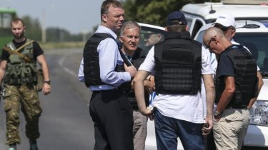 Alexander Hug (front, centre), deputy head for the Organisation for Security and Cooperation in Europe's monitoring mission in Ukraine, stands with members of his team on the way to the MH17 site on Wednesday.