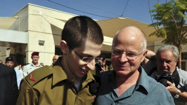 Free ... Gilad Shalit, left, puts his arm around his father.
