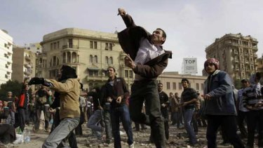 Protesters thrown stones during clashes in Cairo.