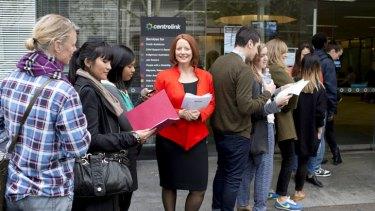 People queue outside an open door with a wax figurine of Julia Gillard