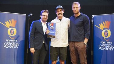 Sam Simmons (centre) receives the Edinburgh Comedy Award from John Kearns and Freddie Flintoff.