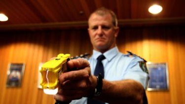 Non-lethal weapon...NSW police officer Bob O'Riordan holds Taser stungun with the double handed Glock grip. More police will undergo Taser training in the next few weeks.