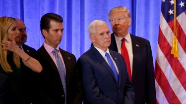 President-elect Donald Trump listens with Vice President-elect Mike Pence, daughter Ivanka Trump and Donald Trump Jr. as one of his attorneys speaks during a news conference.