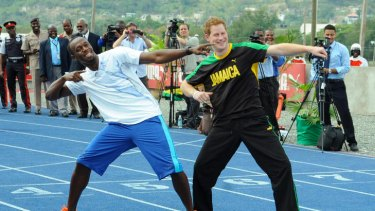 Prince Harry and Usain Bolt pose for photographers.
