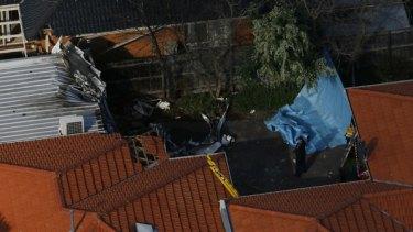 Police survey the scene of a  light plane crash in Chelthenham
