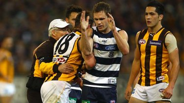 Brent Guerra remonstrates with Joel Selwood.