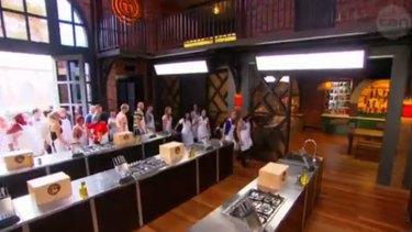 The top 24 walk into the <i>MasterChef</i> kitchen.