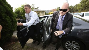 Detectives arrive to drag Roger Rogerson from his Padstow Heights home.