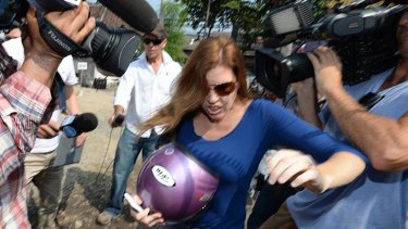 Sister Mercedes Corby battles the media throng outside the prison.