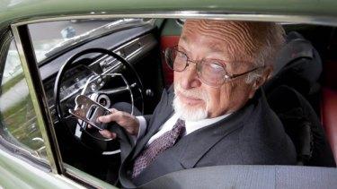 Professor Peter Joubert sits in a 1960 Volvo.