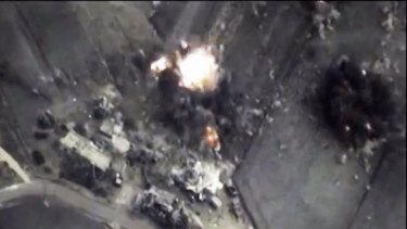 This image from the Russian Defence Ministry shows a Russian Air Force bomb hitting a target in Syria. A spokesman for Russian President Vladimir Putin admitted on Thursday that Russia's air strikes in Syria are targeting not only Islamic State militants but also other groups.