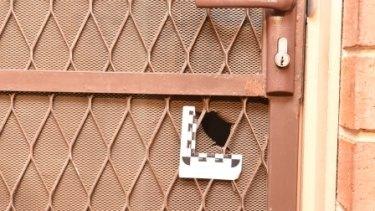 Leonie Stuart was shot through the screen door of her home.
