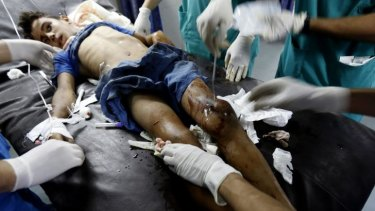 A wounded boy from the Bakr family, receives treatment at al-Shifa hospital, in Gaza City.