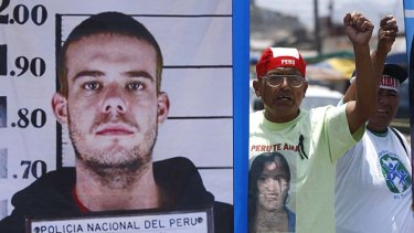 People protest against Joran van der Sloot as they hold up an enlarged picture of his police mugshot.