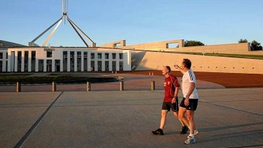 Queensland Premier Campbell Newman and Prime Minister Tony Abbott return to Parliament House after an early morning run around Lake Burley Griffin.
