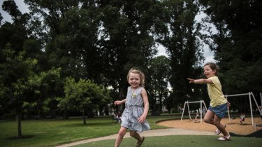 Sisters Ruby and Evie play in the Carlton Gardens.