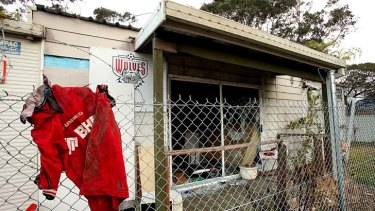 Hard times ... the abandoned demountable building at Lysaghts Oval still features the Wolves badge.