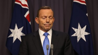Prime Minister Abbott responds to Malcolm Turnbull's leadership challenge at Parliament House on Monday.