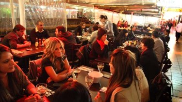 A United Nations selection of cuisines ... diners at night in the Church Street Mall.