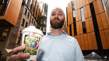 Marco Tschannen grabs a coffee near work on Wednesday.