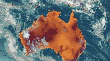 A satellite image shows cyclones threatenening both east and west coasts of Australia at 9.30pm Friday.