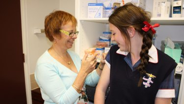 A girl receives  the HPV vaccine.