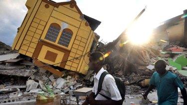 People among the ruins of earthquake devastated Port-au-Prince.