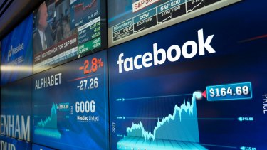 Facebook stock values are shown on a screen at the Nasdaq MarketSite.