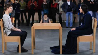 Eye-level art: Marina Abramovic at The Museum of Modern Art in 2010 performing <i>The Artist is Present</i>.