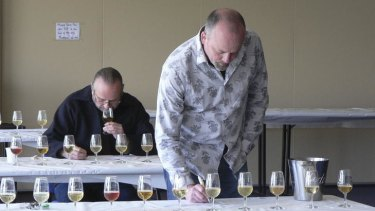 Judges Willie Simpson and Neal Cameron making sense of a very competitive cider class.
