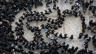 Ultra-Orthodox Jews gather in Jerusalem to demonstrate against plans to make them undergo military service.