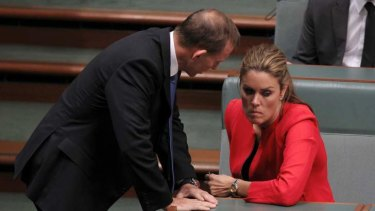 Mutual loyalty: Prime Minister Tony Abbott, then opposition leader, speaks to his chief of staff Peta Credlin in Parliament.