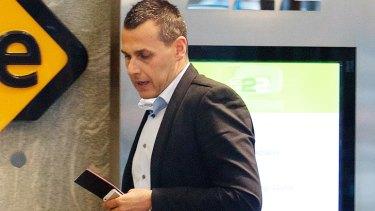 Phobe Handsjuk's boyfriend Antony Hampel leaves the Coroner's Court.