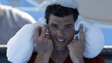 Keeping cool: Frank Dancevic applies an ice pack to his head.