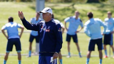 Graham Arnold directs a training session at Macquarie Field on Thursday.