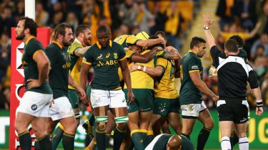 Try time: Wallabies veteran Adam Ashley-Cooper celebrates scoring.