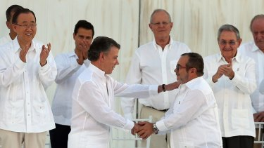 Historic agreement: Colombian President Juan Manuel Santos, front left, and the top FARC commander Rodrigo Londono, known by the alias Timochenko, shake hands after signing the original peace deal.