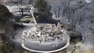 """The deadly European heatwave of 2003, the fiery Russian heatwave of 2010 and catastrophic droughts in Texas and Oklahoma last year can each be attributed to climate change"" ... the remains of a house at Possum Kingdom Lake, Texas, in April 2011."