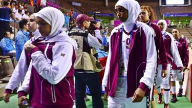 Qatar's women's basketball team leaves the court after forfeiting their women's basketball game against Mongolia.