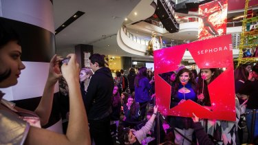 Thousands queue up the opening of the new Sephora store at Melbourne Central.