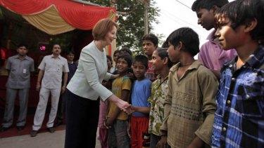 PM Julia Gillard visits Asha, which helps educate slum children.