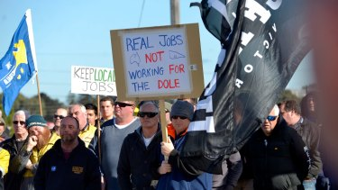 Workers rally at Webb Dock on Tuesday.