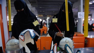 Pakistani workers glue a design onto footballs ahead of the FIFA World Cup 2014 in Brazil at Forward Sports factory in Sialkot.