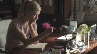 Word play: Amy (Rosamund Pike) considers one of her diary entries in the thriller <i>Gone Girl</i>.