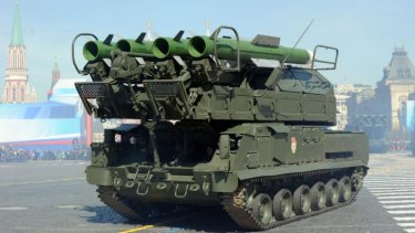 This file picture shows a Russia's air defence system Buk-2M armoured launcher vehicle at the Red Square in Moscow during Victory Day parade on May 9, 2013.