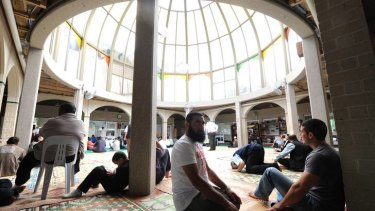 Muslims gather at the Preston Mosque.