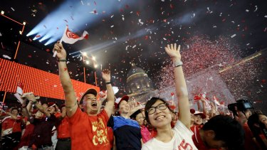 Confetti is released at the end of Singapore's celebration parade at Padang, near the central business district, on Sunday night.