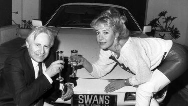 Those were the days ... Geoffrey Edelsten and former wife Leanne toast buying the Sydney Swans licence in 1986 ... and went about promoting the club in all sorts of ways