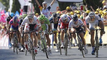 Beaten to the line: Andre Greipel sprints to vicotry ahead of Mark Cavendish, second right.